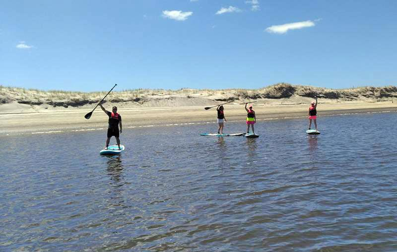 Introduction to paddleboarding lesson - Aotearoa Surf