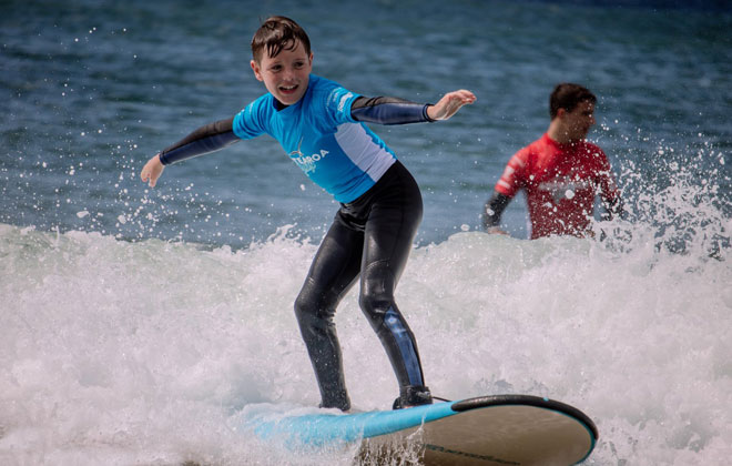Kids surfing - school holiday programs, mini surfers, fun and safety on the water