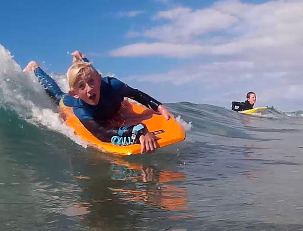 Outdoors adventure club - school holiday surfing and adventure programmes by Aotearoa Surf