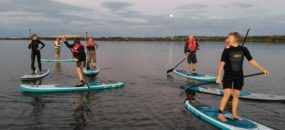 Group surfing and paddleboarding programs