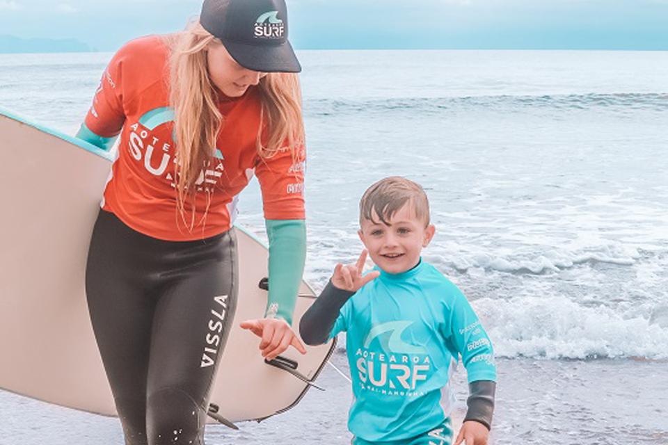 Aotearoa Surf School Coach teaching surf lesson